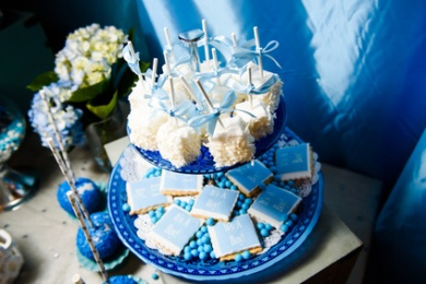 Blue tired dish with blue and white sweets