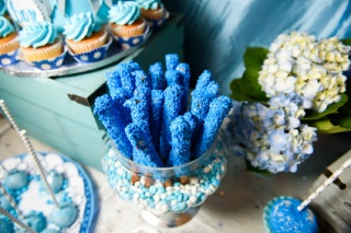 Sweet sticks with blue glaze stand in glass bowl