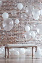 Bench Near Balloons On Brick Wall Background