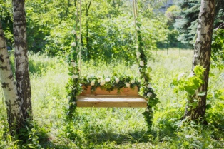 swing overgrown with flowers in the park