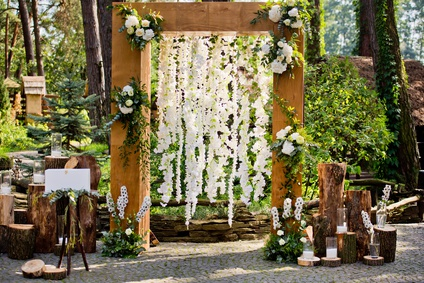 Arch for the wedding ceremony in a rustic style. Wedding decorations.